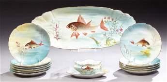 Thirteen Piece Limoges Porcelain Fish Set, by M. Redon,