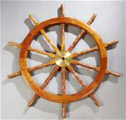 Carved Mahogany And Brass Ship's Wheel, late 20th c.,
