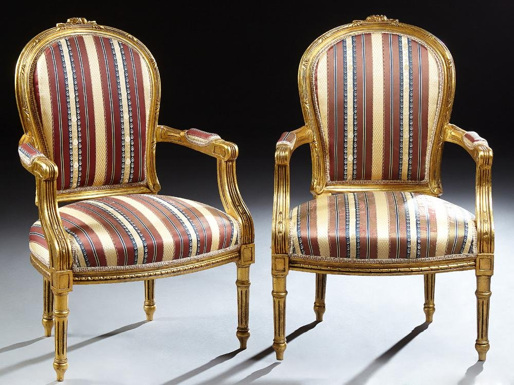 Pair of Gilt Louis XVI Style Fauteuils, 20th c., the