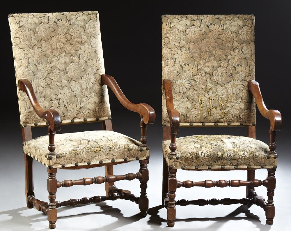 Pair of French Louis XIII Style Carved Walnut Fauteuils