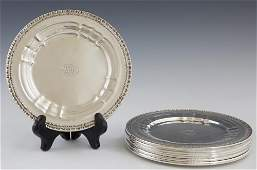 Set of Seven Sterling Bread and Butter Plates, 20th c.,