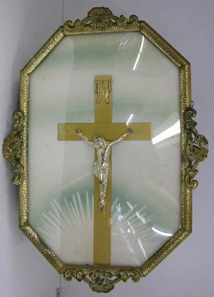 2: Metal Crucifix, c. 1920, mounted in a polychromed br