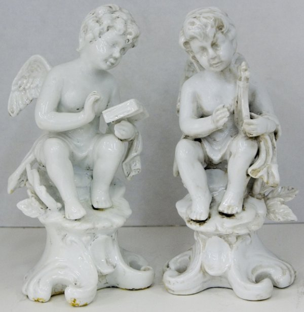 10: Pair of White Porcelain Putti, 19th c., in the styl