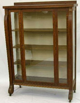 16: American Carved Oak Curio Cabinet, c. 1910, with a