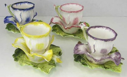 6: Set of Eleven Floriform Ceramic Cups and Saucers, 20