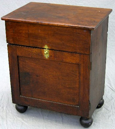10: An American Late Classical Carved Mahogany Commode,