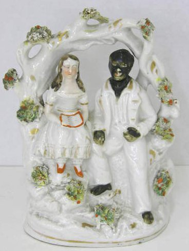 18: Rare Staffordshire Figure of Uncle Tom and Little E