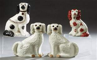 Group of Four English Staffordshire Dogs, 19th c.,