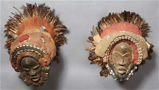 Pair of Kuba African Masks, early 20th c., with cowrie