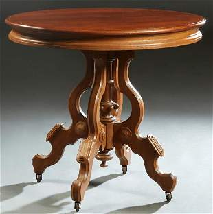American Carved Walnut Oval Lamp Table, late 19th c.,