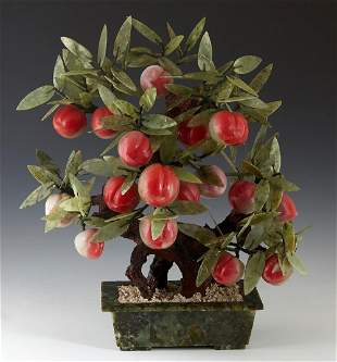 """Chinese Carved Jade Peach """"Tree,"""" 20th c., in a green"""