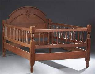 American Carved Walnut Youth Bed, late 19th c., the