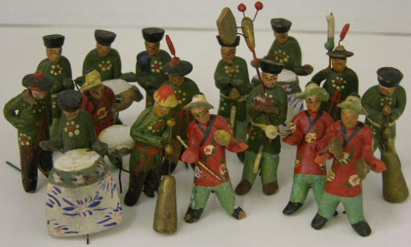 751: Unusual Group of Sixteen Polychromed Clay Chinese