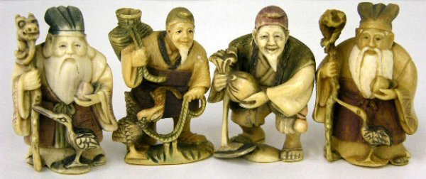 752: Group of Four Polychromed Ivory Netsukes, early 20