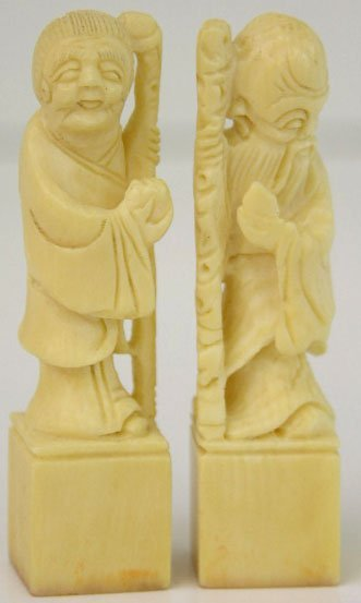 762: Pair of Figural Carved Ivory Chops, early 20th c.,