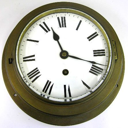 22: Brass Ship's Clock, 20th c., with a thick beveled g
