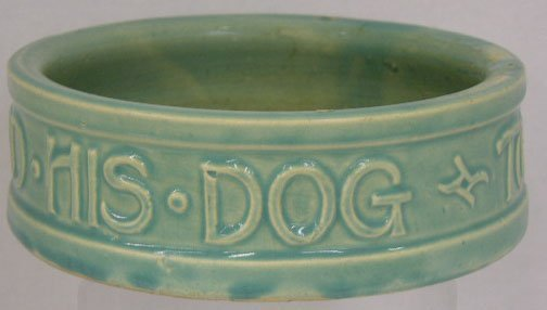 27: Green McCoy Pottery Dog Bowl, 20th c., the sides wi