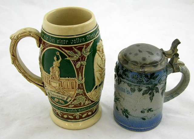 21: Two German Stoneware Steins, c. 1900, one with a hi