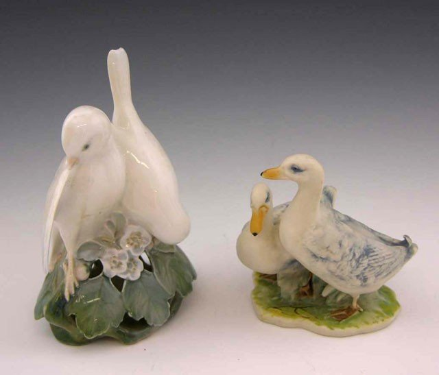 8: Two Polychromed Porcelain Bird Figurines, 20th c., o