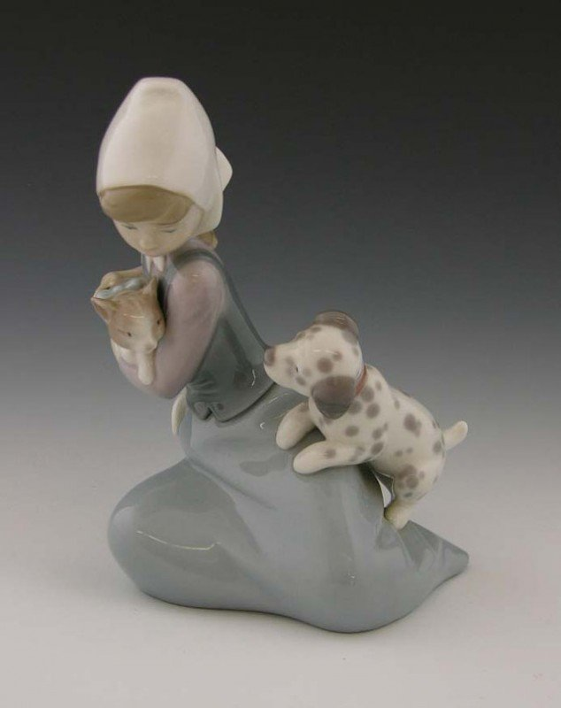 19: Lladro Glazed Porcelain Figure, of a girl with a ca