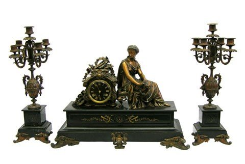 539: Three Piece Patinated Spelter and Black Granite Cl