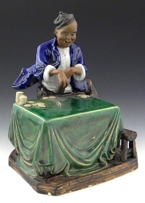 11: Oriental Glazed Earthenware Figure, 20th c., of a d