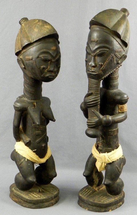 7: Pair of African Carved Wood Spiritual Partners Statu