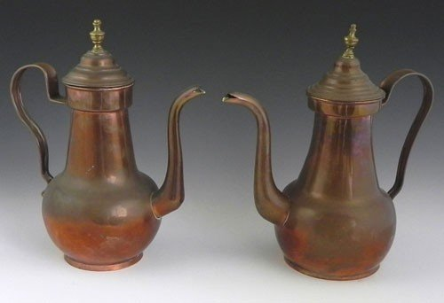 32: Pair of Copper Coffee Pots, early 20th c., the lids