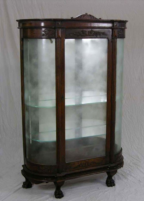 44: Carved Oak Curved Glass Curio Cabinet, c. 1900, wit