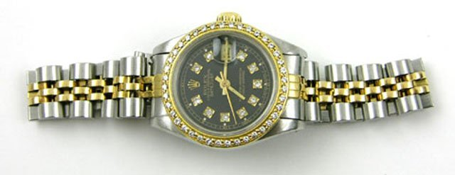 362: Lady's 18K Yellow Gold and Stainless Steel Rolex O