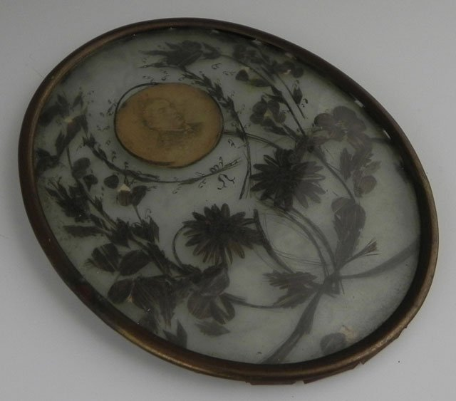 774: Two Mourning Items, 19th c., consisting of an oval