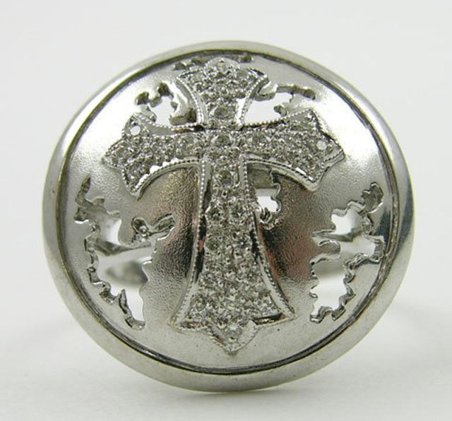 881: Lady's 18K White Gold Cross Ring, the domed top wi