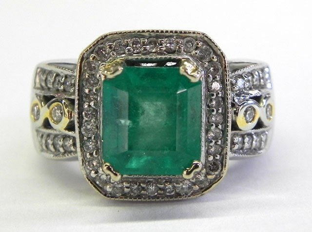 883: Lady's 14K White Gold Dinner Ring, with a central