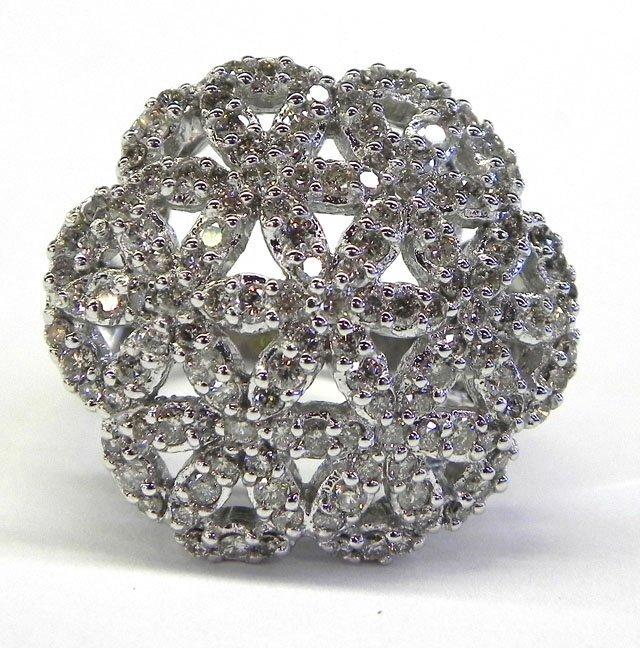 884: Lady's 14K White Gold Dinner Ring, the scalloped c