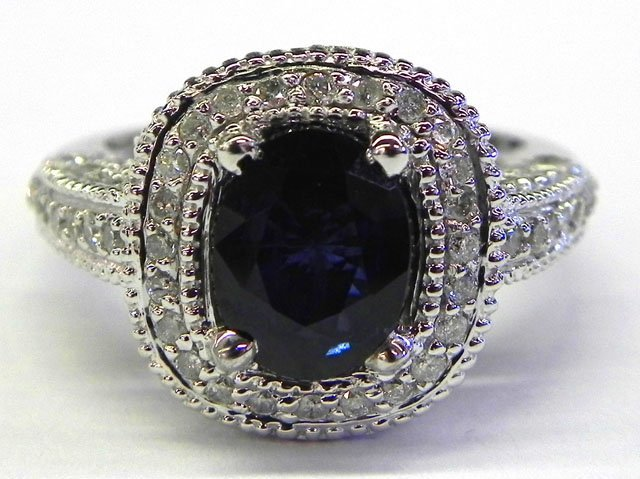 886: Lady's 14K White Gold Dinner Ring, with an oval 2.