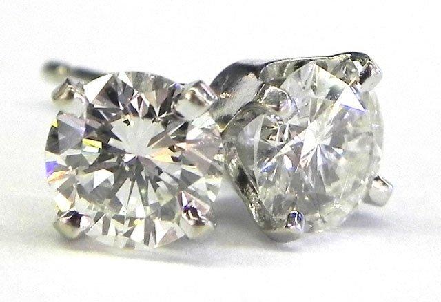 889: Pair of 14K White Gold Diamond Stud Earrings, each