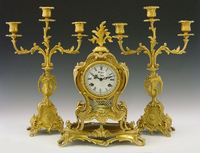 479: Louis XV Style Three Piece Gilt Bronze Clock Set,