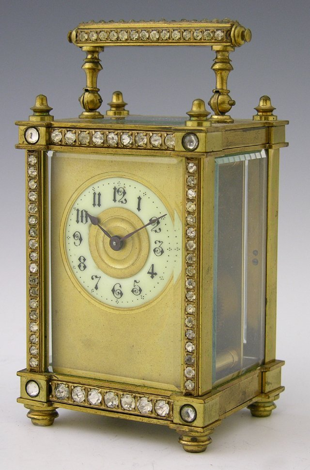 1236: Brass Carriage Clock, early 20th c., the handle a