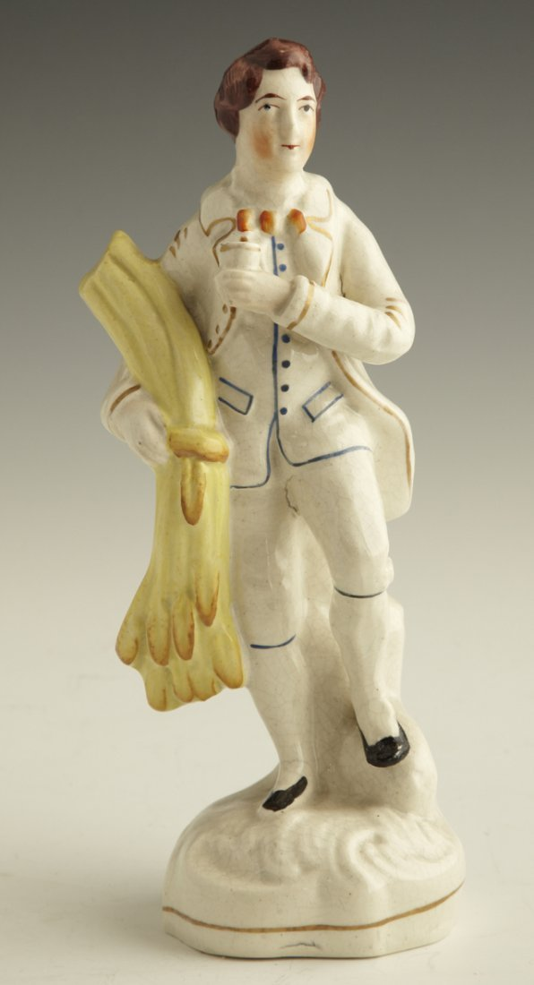 3: Staffordshire Figure, mid 19th c., of a man with a s