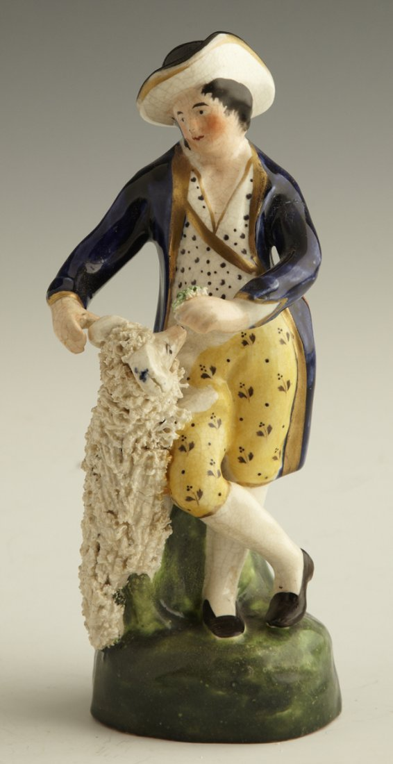 19: Staffordshire Figure, mid 19th c., of a man and a d