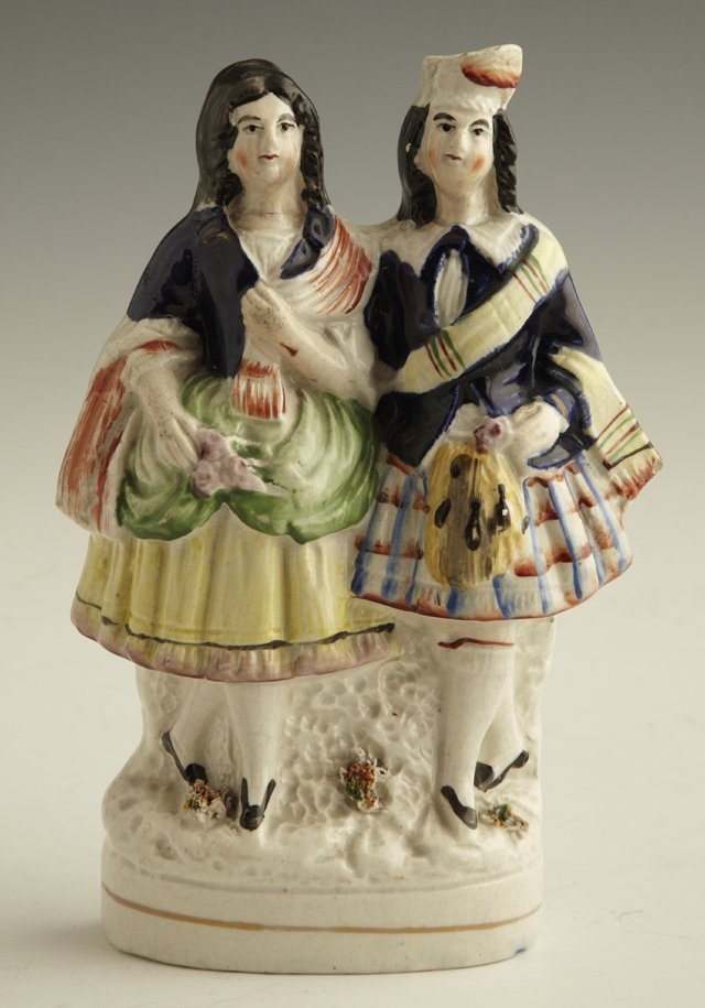 21: Staffordshire Figural Group, mid 19th c., of a Scot