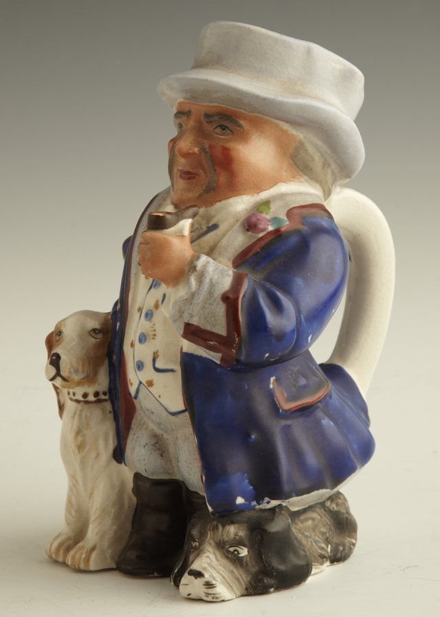 22: Ceramic Toby Jug, 19th c., of a man with his dog an