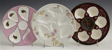 38: Group of Three Oyster Plates, 19th c., one of Majol