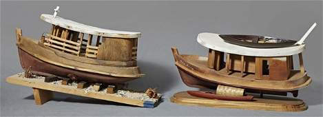 129: Two Carved Wooden Amazon Basin Model Boats, 20th c