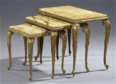 Nest of Three Brass and Onyx Tables, early 20th c., the