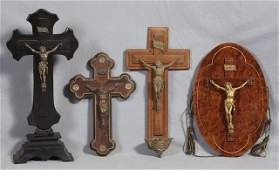 Group of Four Crucifixes, early 20th c., one of rosewoo