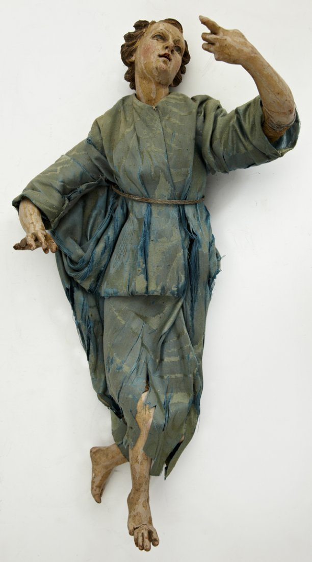 Carved Wood Painted Santo Figure, 19th c., clad in a bl
