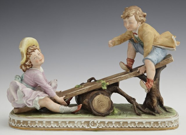 Italian Porcelain Figural Group, 20th c., of a boy and
