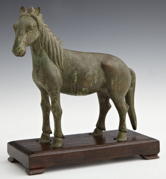 Chinese Bronze Horse, 20th c., on a custom carved mahog