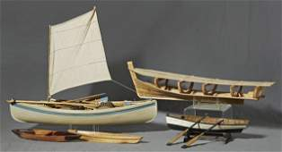 Group of Five Carved Wooden Model Boats, 20th c., a row